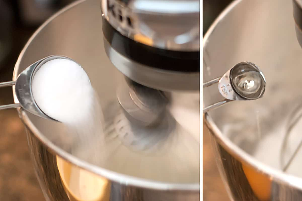 Adding sugar-cornstarch mixture and vanilla to beaten egg whites.