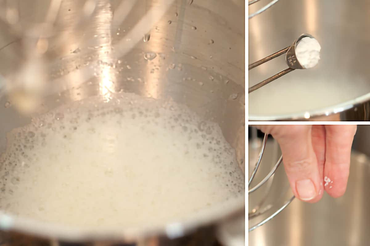 Beating egg whites in a stand mixer bowl.