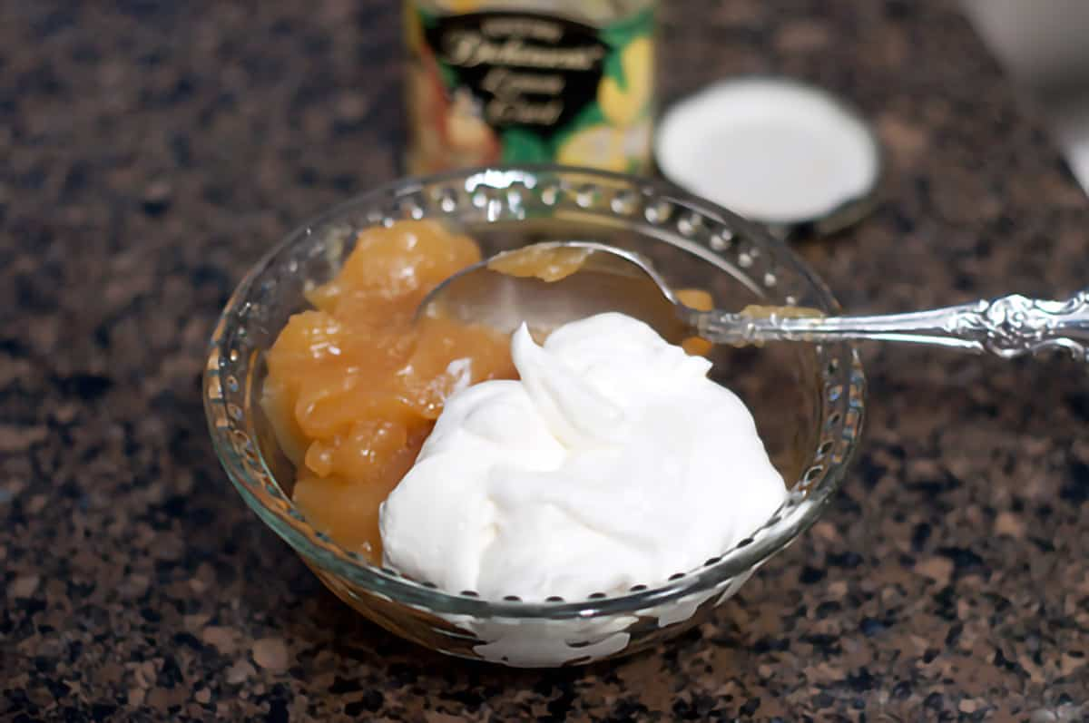 Lemon curd and sour cream in a small mixing bowl.