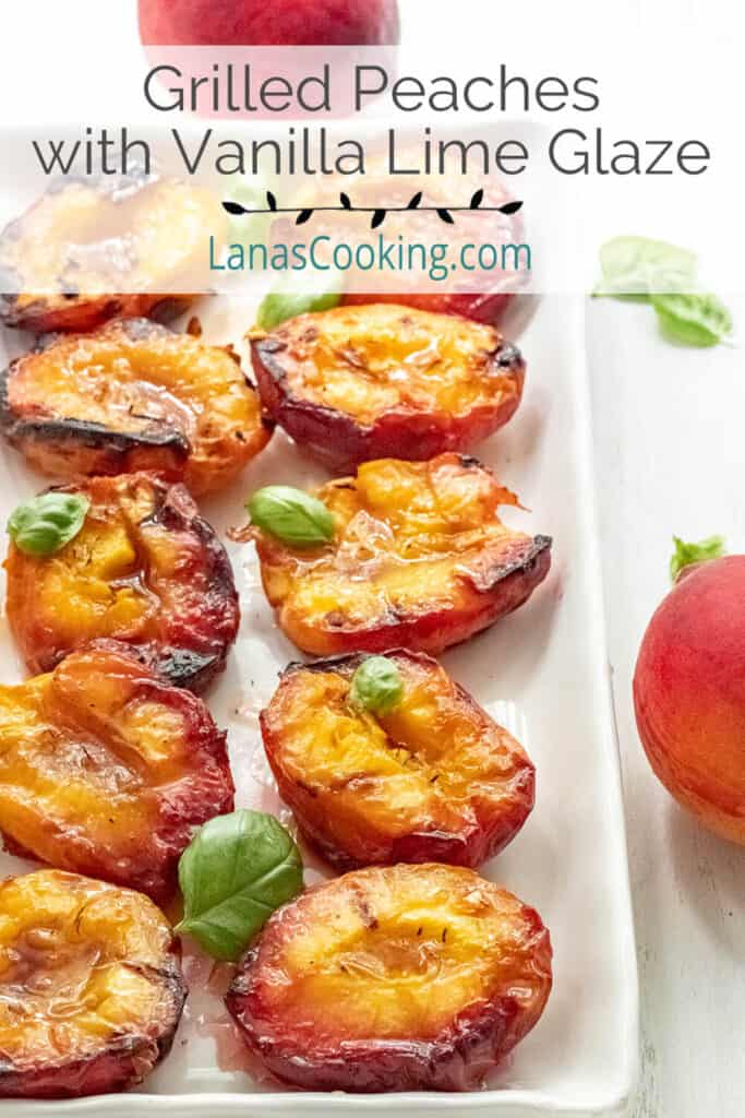 Grilled peaches on a white serving plate.