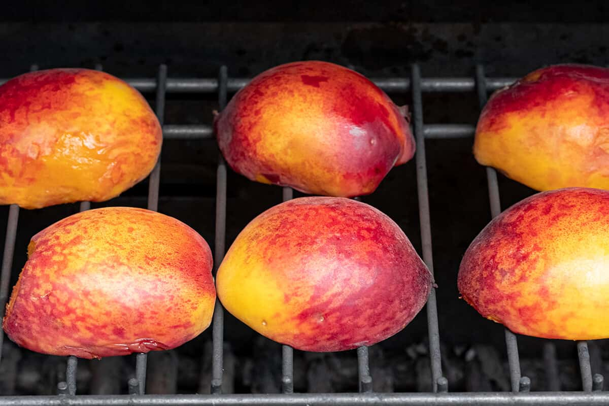 Peaches on a grill rack.