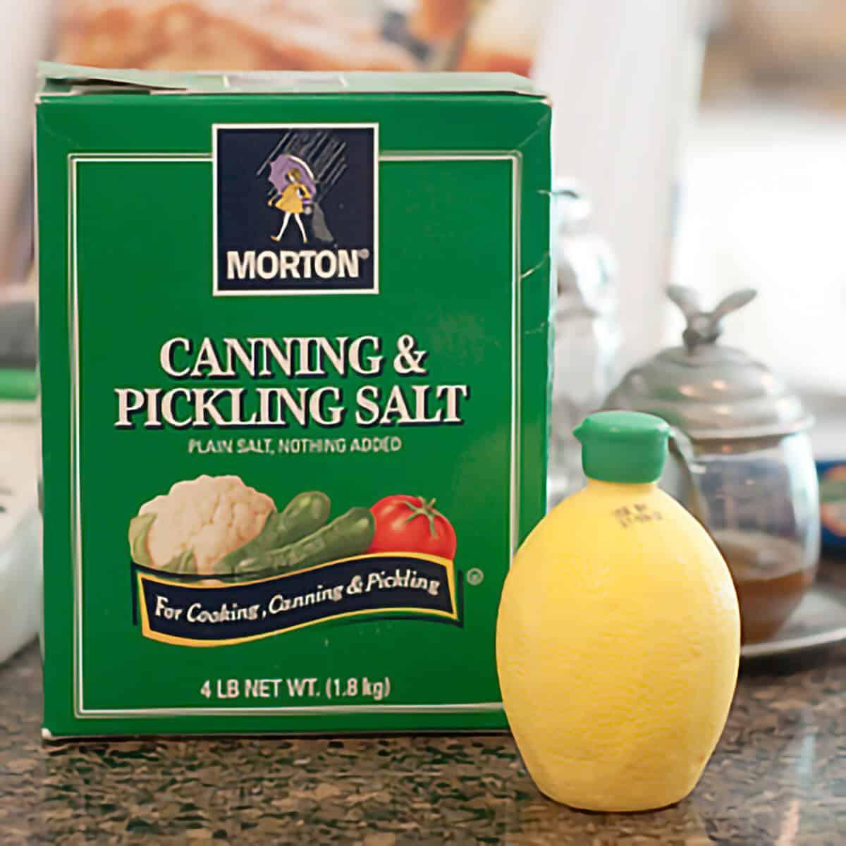 A box of pickling salt and bottled lemon juice.