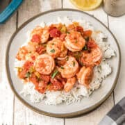 A serving of Louisiana Shrimp Creole over white rice on a plate.