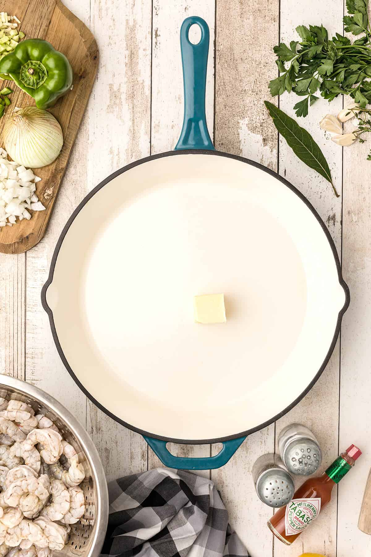 Butter melting in a skillet.