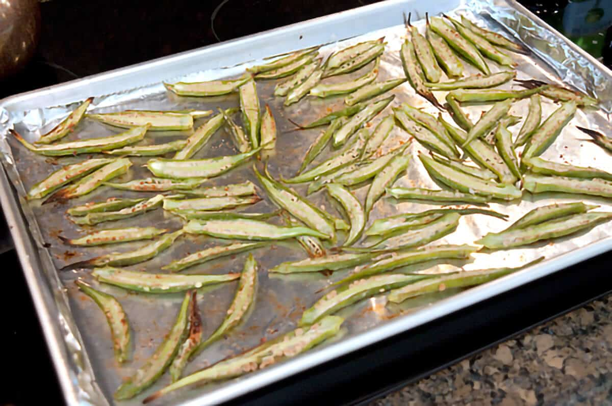Okra chips after initial 20 minutes of roasting.