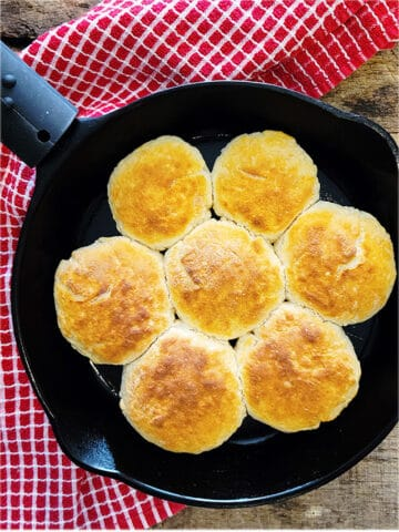 Buttermilk biscuits in a cast iron skillet.
