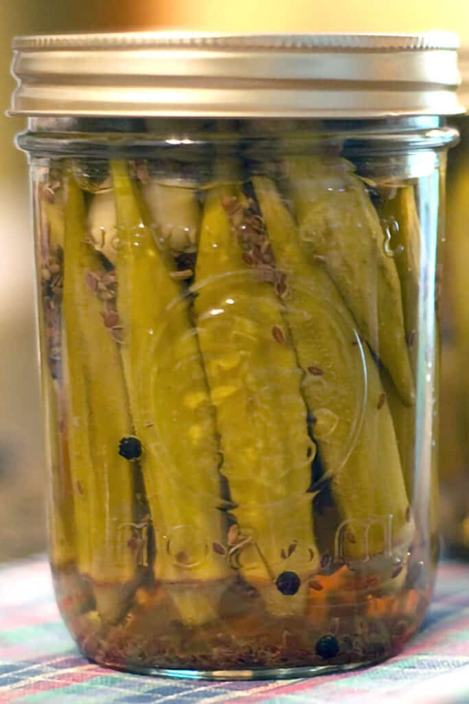 Canning jars filled with homemade pickled okra.
