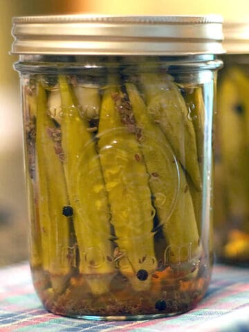 Canning jars filled with pickled okra.