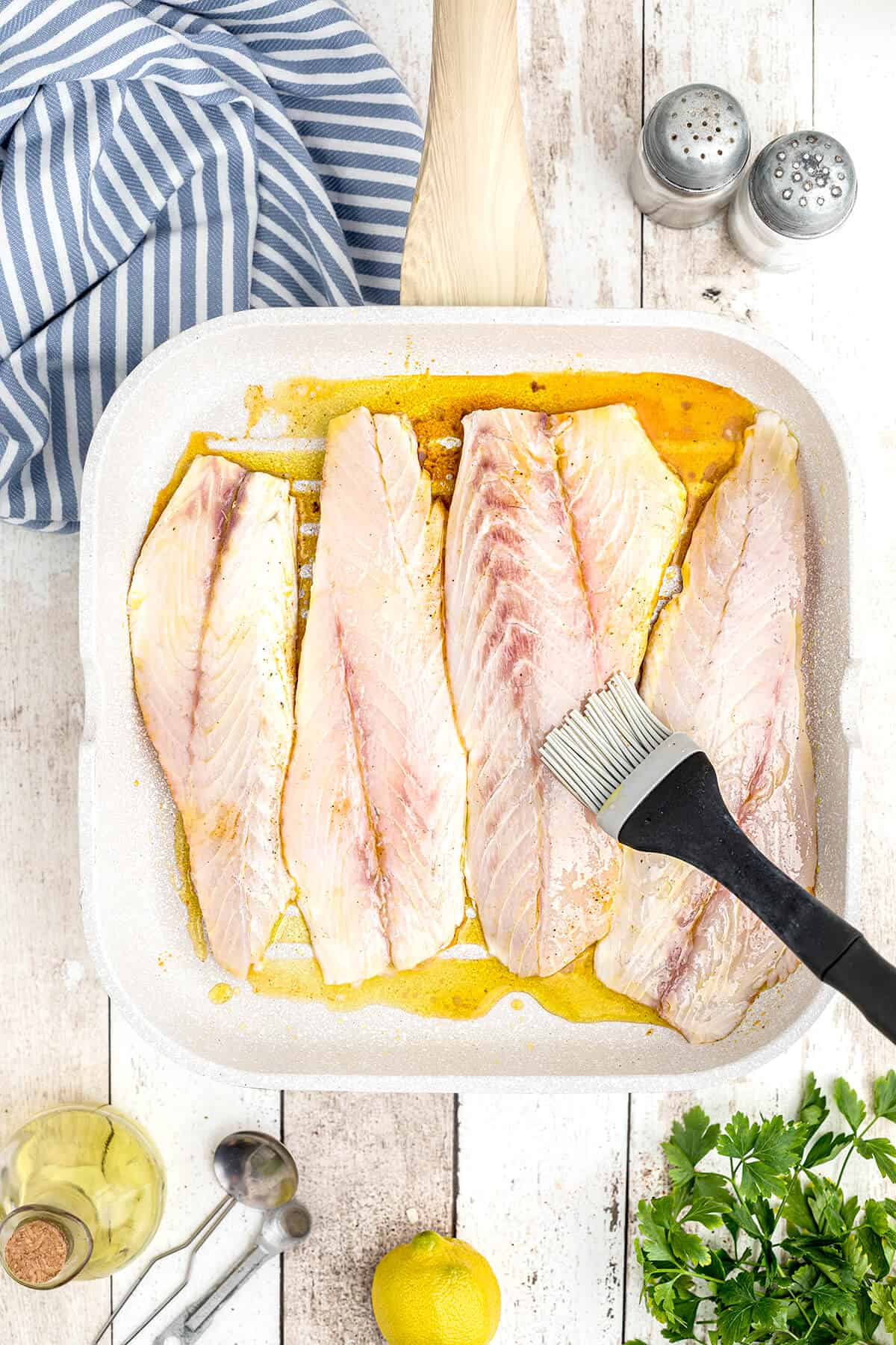 Fish fillets on a grill pan.