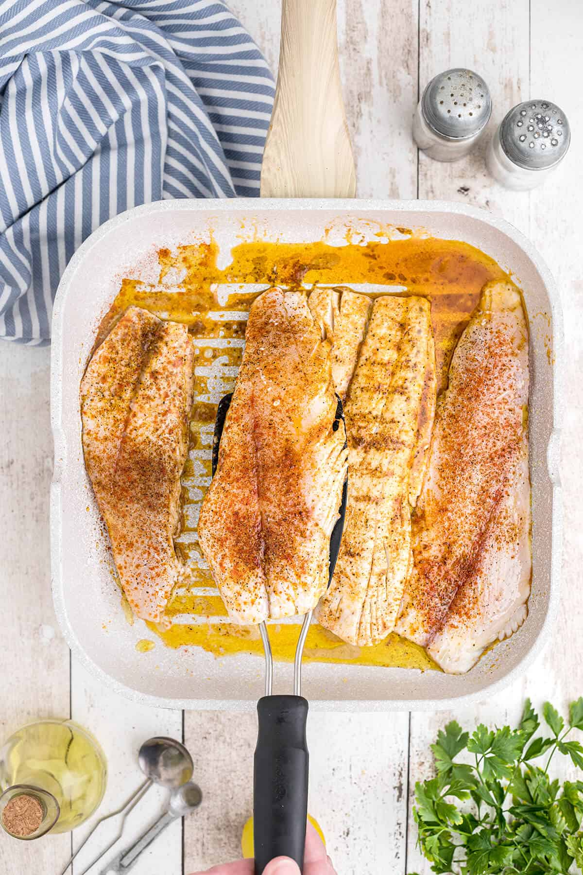 Fish fillets cooking in a grill pan.