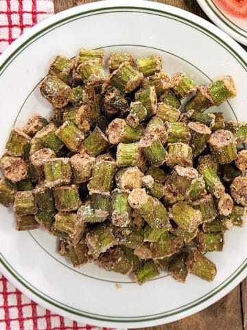 A plate heaped with golden brown fried okra.