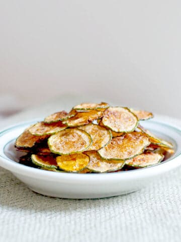Zucchini chips in a white bowl.