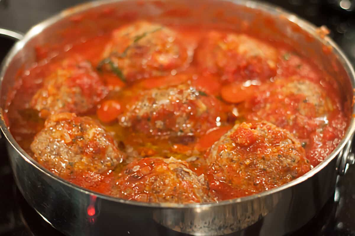 Browned meatballs added to the tomato sauce.