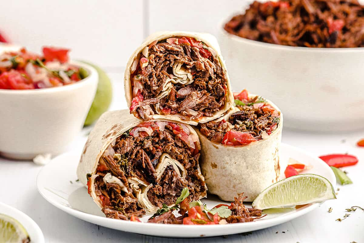Rolled burritos on a serving plate.