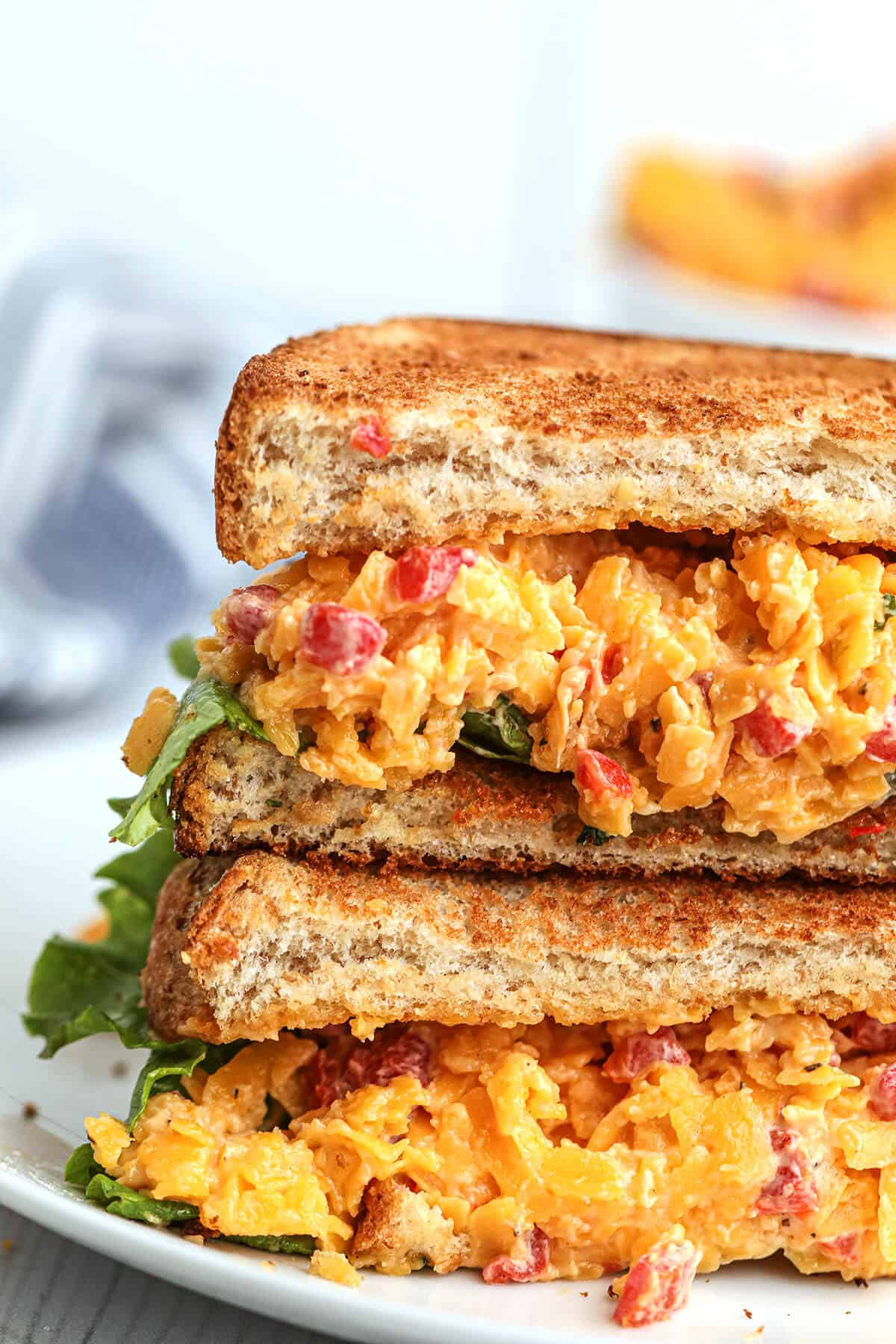 Pimiento cheese sandwich on a white plate.
