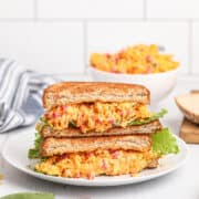 Pimiento Cheese sandwich on a white serving plate.