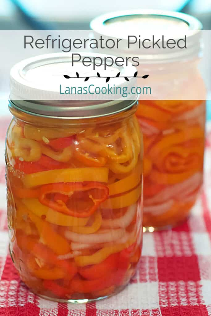 Glass canning jars filled with refrigerator pickled peppers.