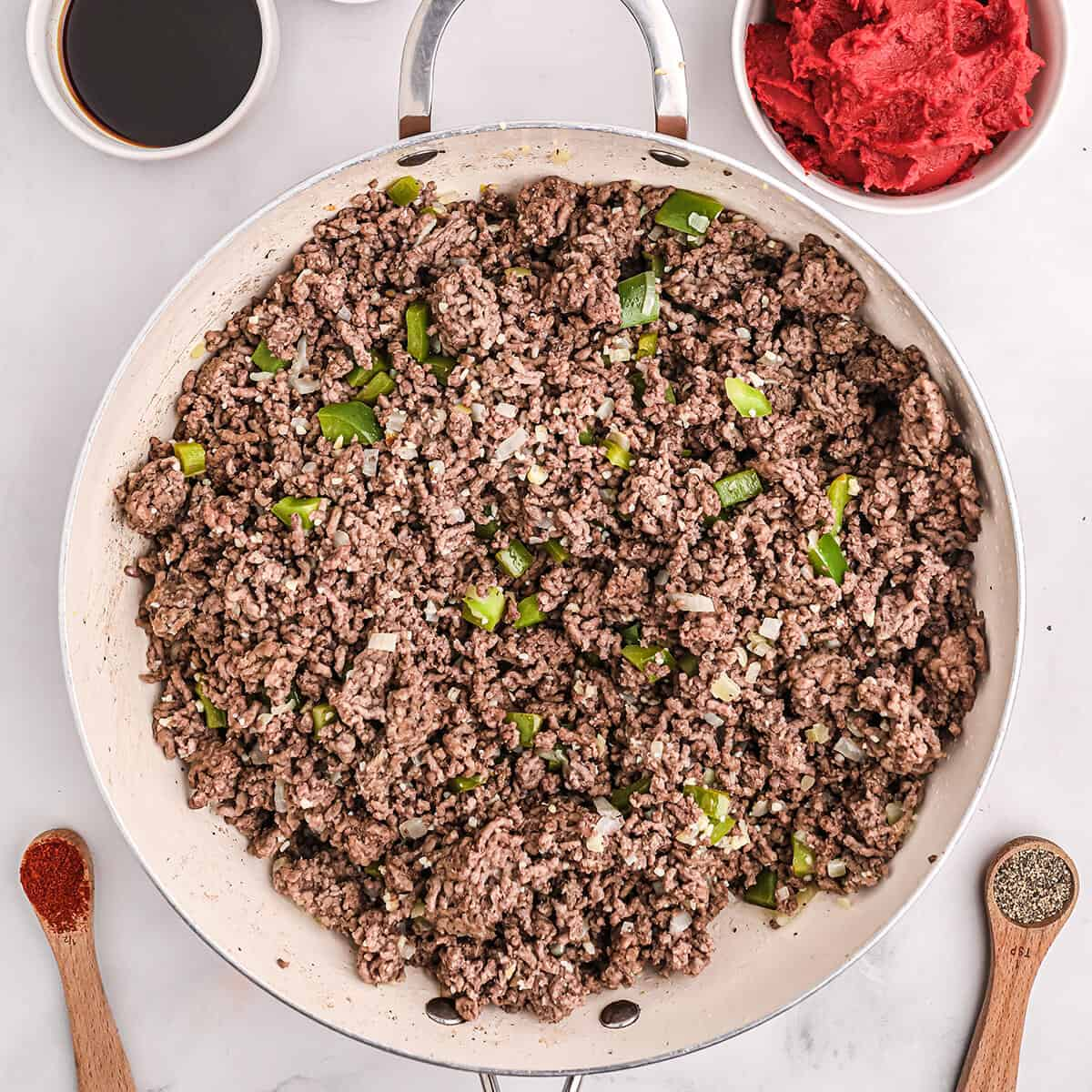 Cooked ground beef with peppers, onions, and garlic.
