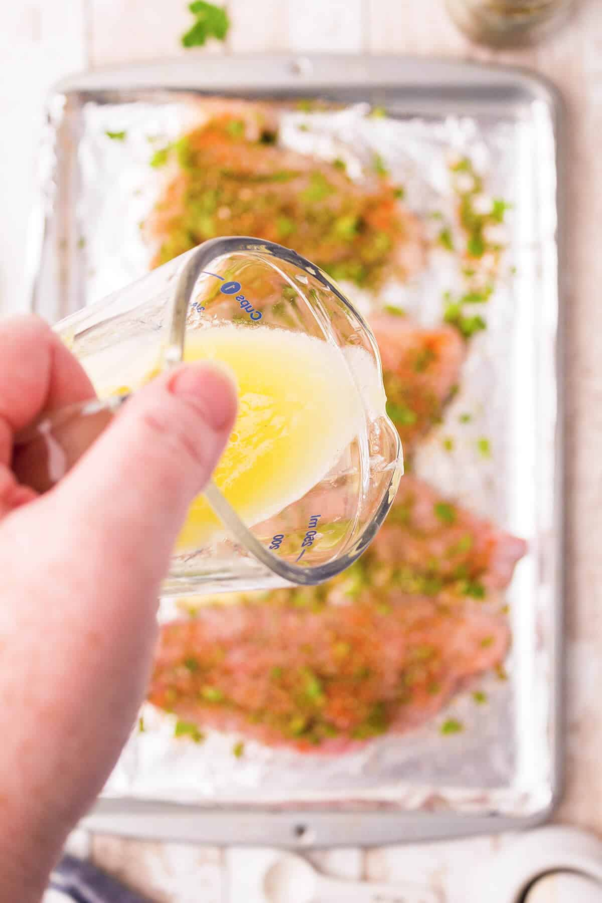 Small cup containing a mixture of melted butter, lemon juice and garlic powder.
