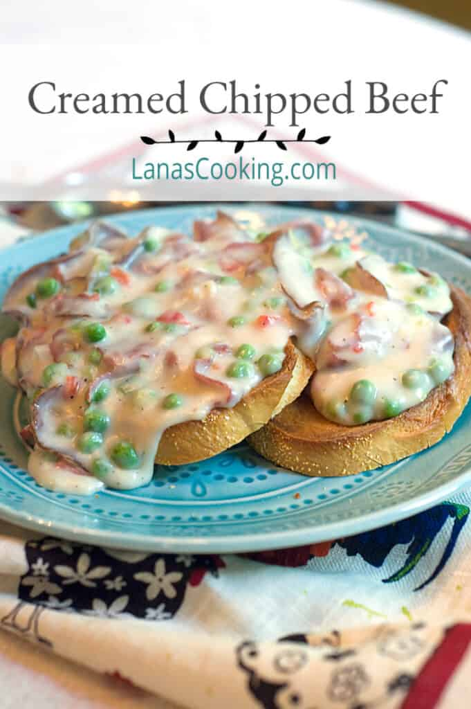 A serving of creamed chipped beef with peas over toast on a blue plate.