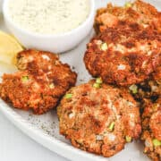 Salmon croquettes on a serving platter.
