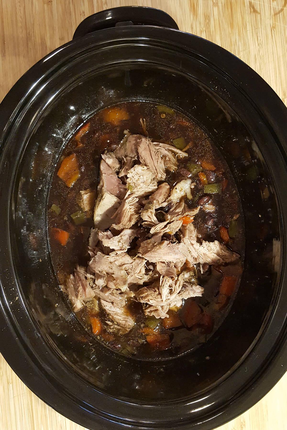 Shredded pork returned to the slow cooker.