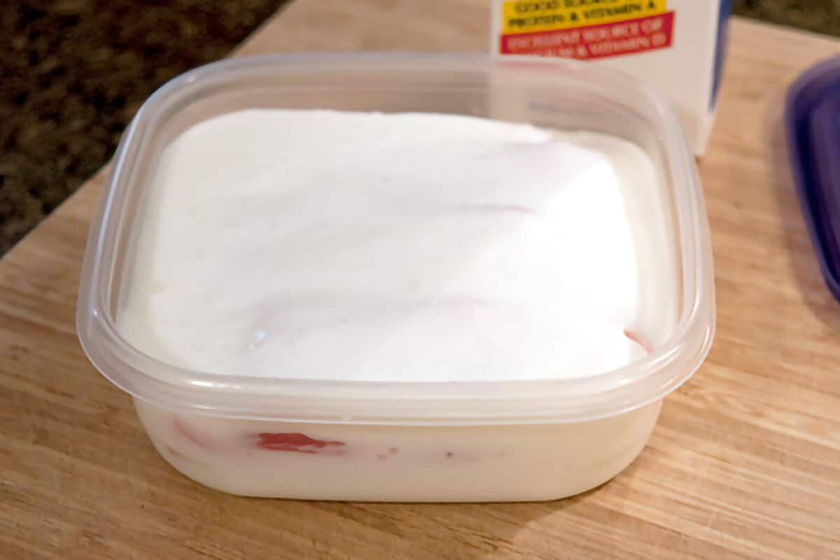 Salt pork and buttermilk in a small dish.